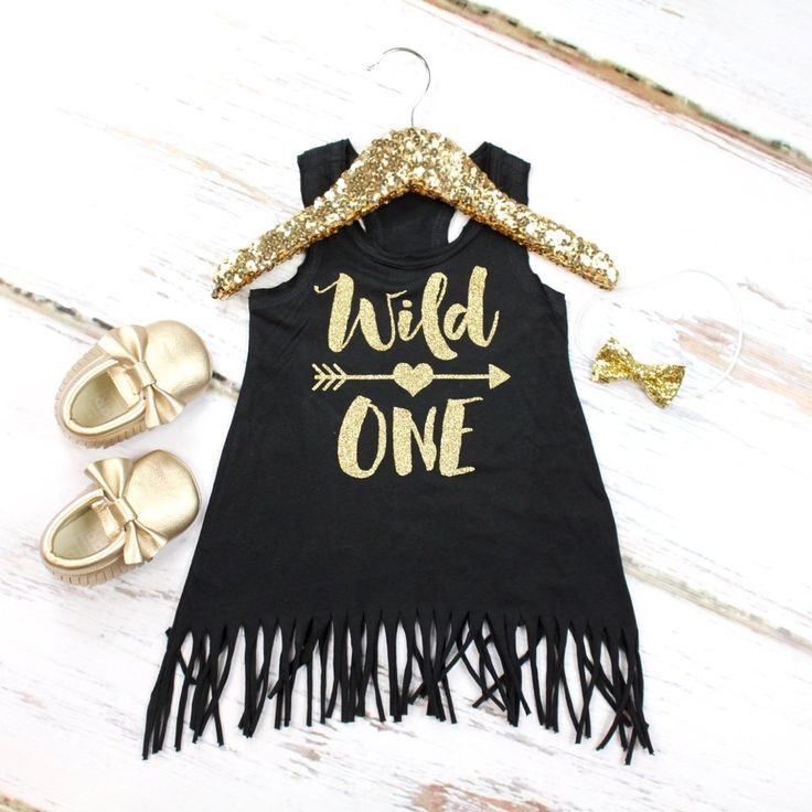 This adorable 1st birthday fringe tank dress is the perfect summer birthday outfit! The dress comes with a glitter gold 'Wild One' w/ Gold Arrow and a little surprise heart detail on the back! The Gold Vinyl is professionally cut and heat pressed on the dress so it does not shed. The outfit also has the option to add a small glitter gold bow on elastic or a clip. THE SHOES ARE NOT INCLUDED, THEY ARE FOR STAGING ONLY*If you are interested in purchasing the moccasins that are also ...