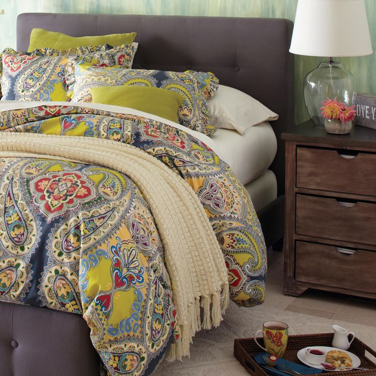 Bedroom Ideas: Gray Upholstered Bed Frame and Colorful Green/Gray Bedding with Mismatched Chestnut Furniture