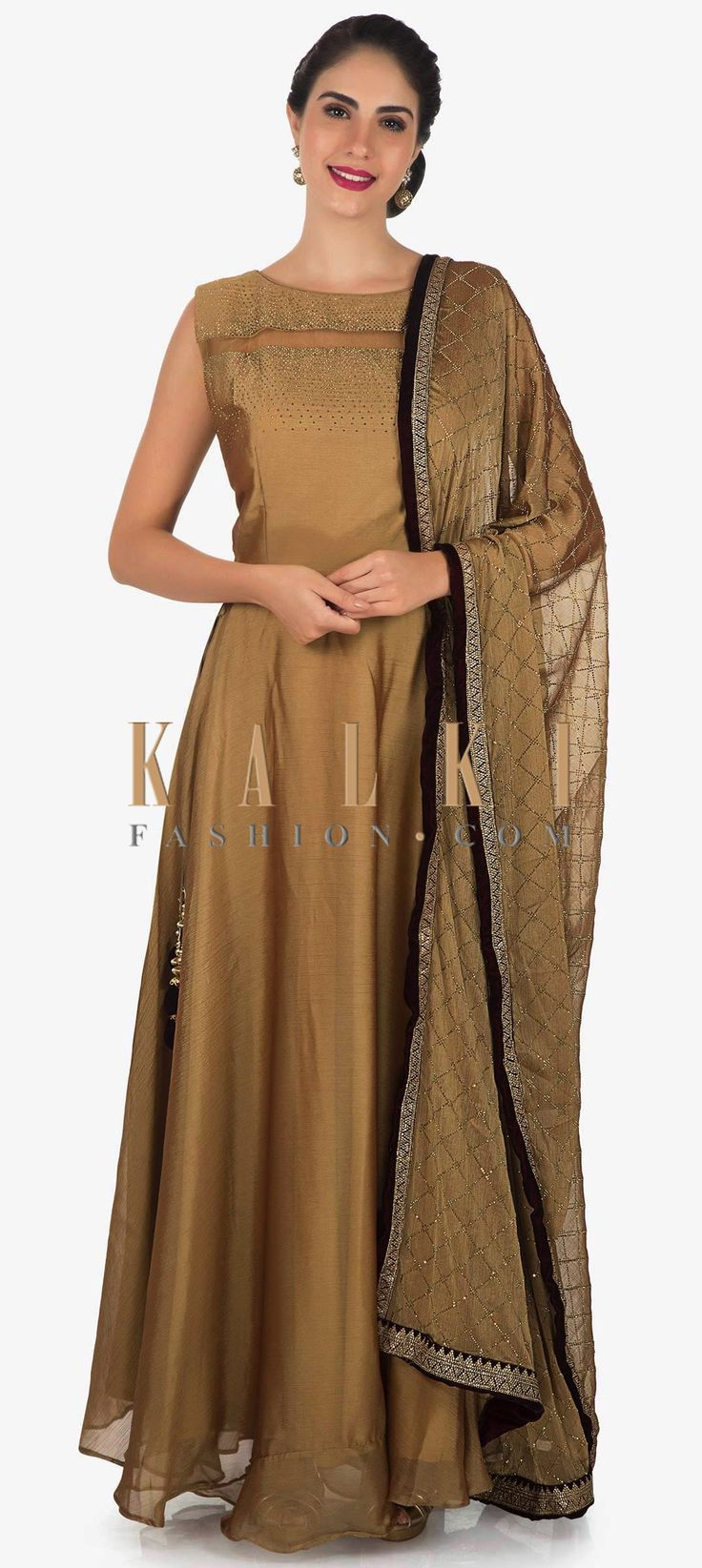 Buy Online from the link below. We ship worldwide Click Anywhere to Tag Brown anarkali suit in chiffon with yoke highlighted in sheer net and kundan only on Kalki  Brown anarkali suit featuring in chiffon. Yoke is embellished in kundan work along with sheer net. It comes with boat neckline and sleeveless. Matched with lycra churidar and dupatta in chiffon with wine velvet border. Slight variation in color is possible.