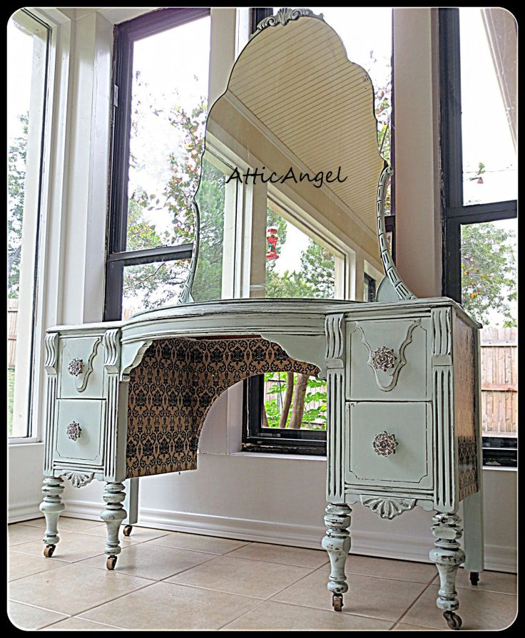 Beautiful Painted Vanity.  Love the knobs and the paper underneath and on the sides!