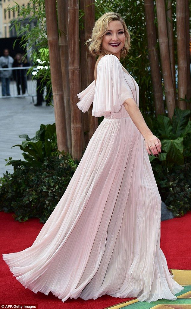 Glamorous gown: Channelling a mix of 'Golden Age' Hollywood glamour with a hint of modern styling, the blonde beauty opted for an understated yet eye-catching wardrobe