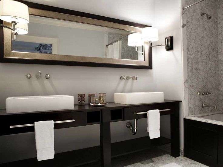 Good Designer Beth Dotolo Gives The Black And White Bathroom A Warm Feel With  Sleek Sconces And A Sophisticated Aesthetic. The Vanity Mirror, Inset With  Shagreen ...