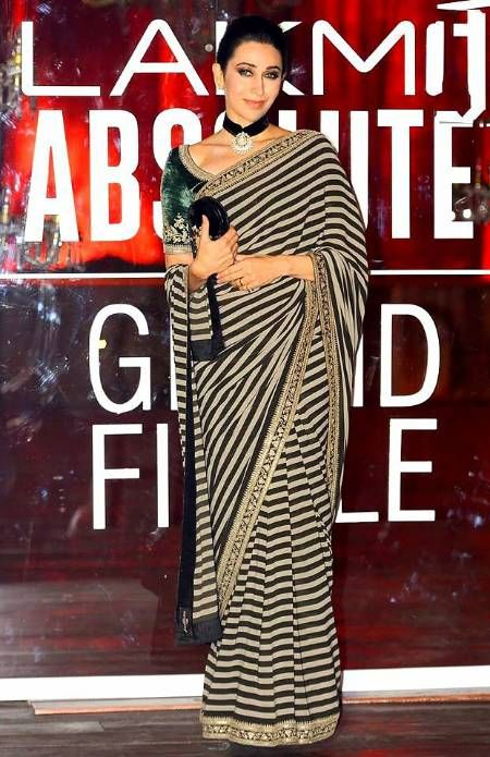 Karishma Shines in Striped Sabyasachi Saree... #KarishmaKapoorrarely dons a saree but when she does she makes sure it is the best, most hatke ensemble you will see. So when she wore this Sabyasachi striped monochrome saree, we weren't too surprised were we?... Get the look at https://www.estrolo.com/whatstrending/karisma-shines-in-striped-sabyasachi-saree/