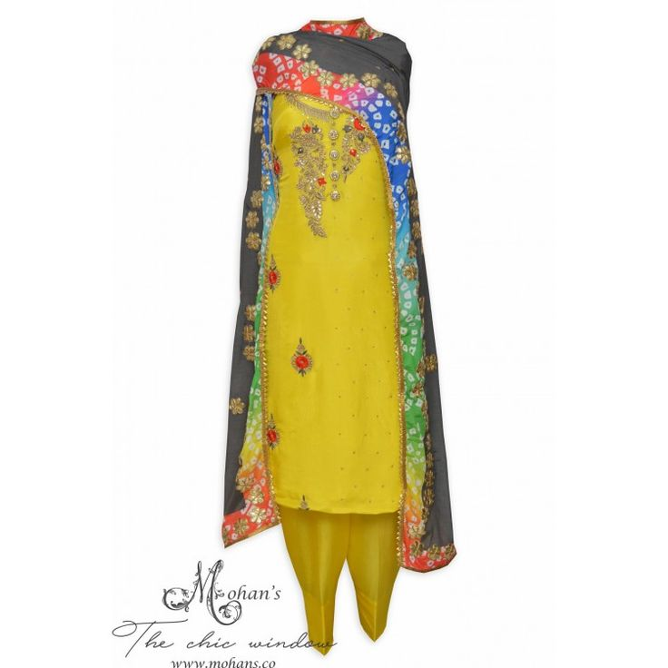 Dazzling daffodil yellow unstitched suit featuring in hand embroidery