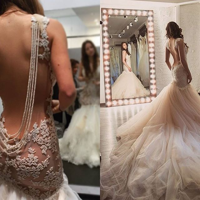 Let's keep on with the most liked bridal fittings of this year! On the right, the stunning @karingmakeup and on the left the famous ballerina @anastasiameskova! Are you into lace or pearls? #GaliaLahav #Fittings #Pickof2015