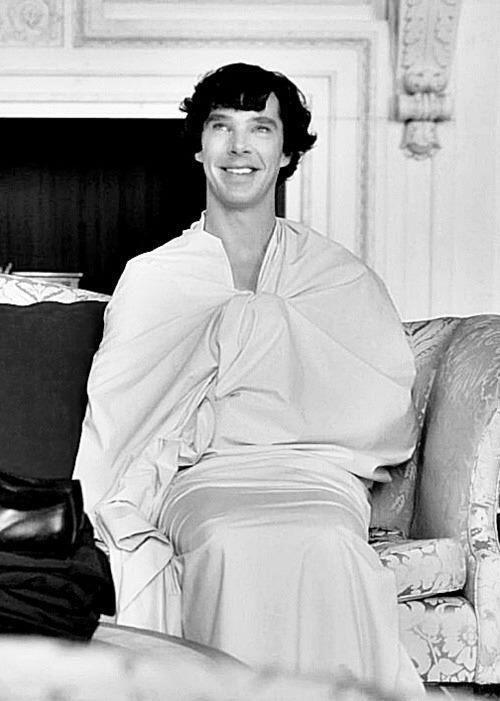 SHERLOCK (BBC) ~ Season 2, Episode 1: A Scandal in Belgravia. Sherlock Holmes (Benedict Cumberbatch) wearing only a sheet at Buckingham Palace.