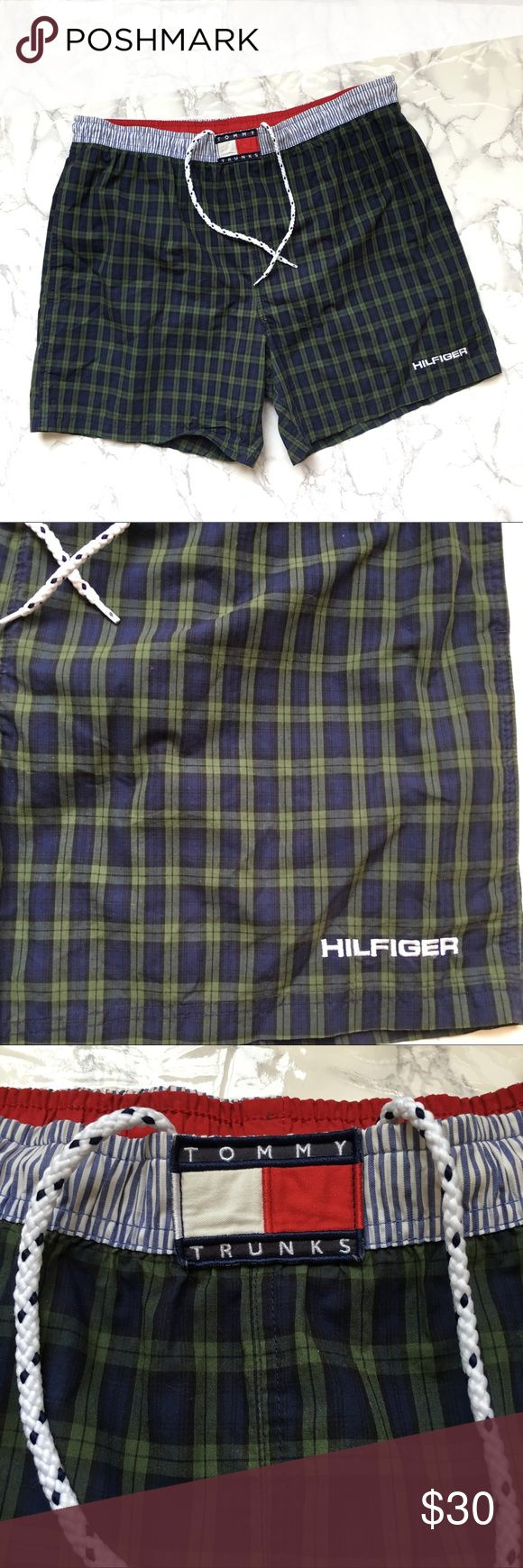 """Tommy Hilfiger Plaid Flag Logo Swim Trunks Tommy Hilfiger """"Tommy Trunks"""" swim shorts. Blue and green plaid. Elastic waistband with drawstring. Mens size Large. Mesh underwear inside. Pockets. Great condition. Features Tommy Hilfiger flag logo on the front. Pocket on the back.     Measurements taken while laying flat: 6"""" Inseam 13"""" Rise 19"""" Waist 17.5"""" Length 24"""" Hips 14"""" Thigh Tommy Hilfiger Swim Swim Trunks"""