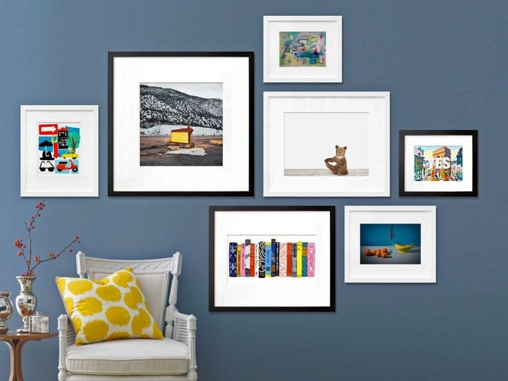"""As you are designing your gallery wall, think about the placement of each piece, particularly when you're hanging art over a sofa or chair. """"When installing artwork over furniture, leave at least eight inches between the base of the frame and the top of the furniture,"""" says Bekman. Be sure not to hang pieces too low or too high. Eye level is best. Image courtesy of 20x200"""