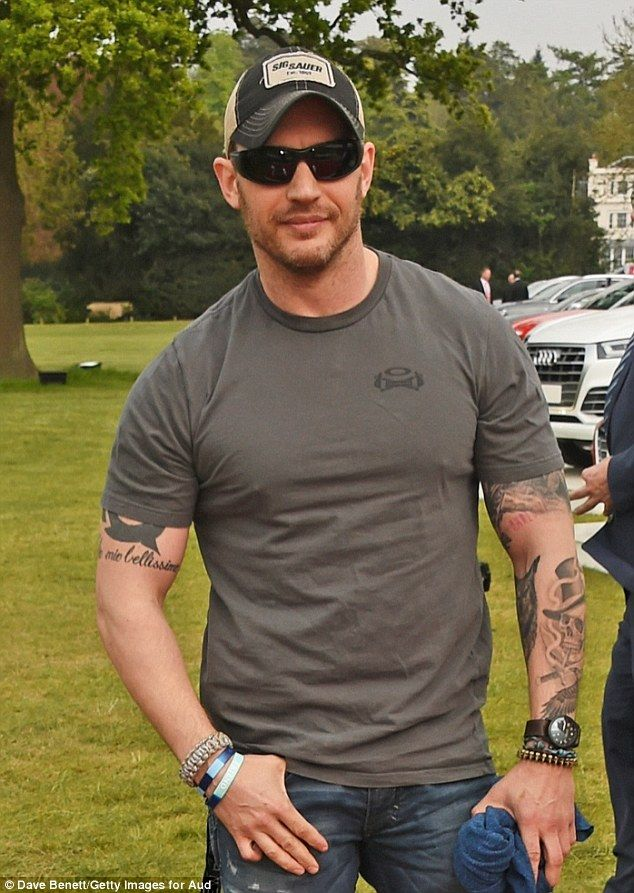 Rugged: Tom Hardy looked handsome in a truckers hat and green t-shirt as he attended the A...