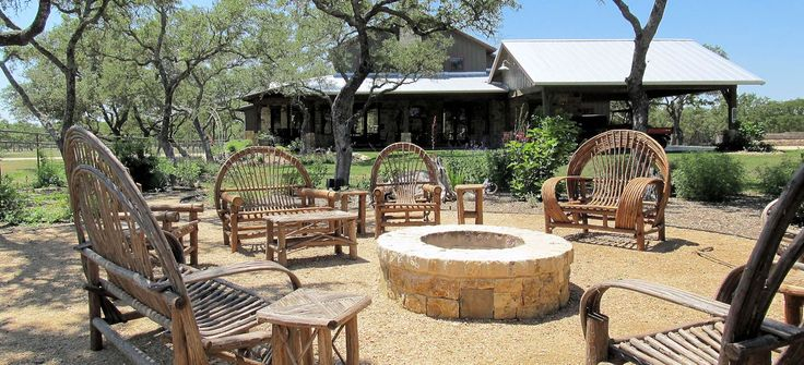 rustic decomposed granite patio with cypress furniture and