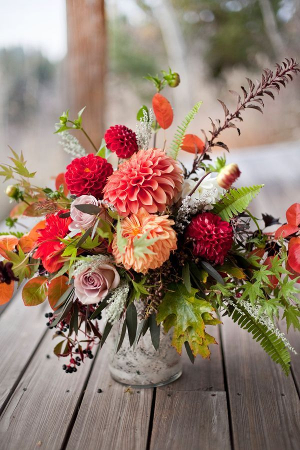 Stunning fall floral arrangement with dahlias, roses and ferns.