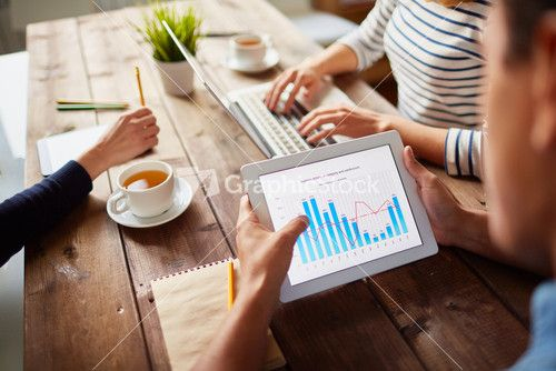 Businessperson Studying Electronic Data In Digital Tablet