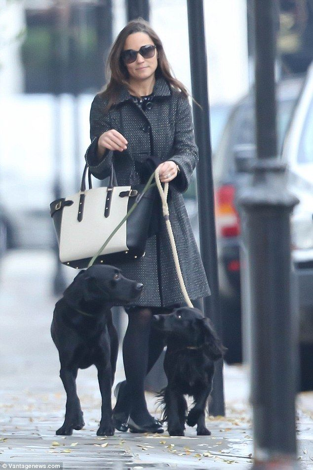 She carried an £950 Aspinal handbag, which perfectly matched her black and white coat...