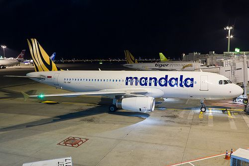 PK-RMT Mandala Airlines A320 at Singapore Changi WSSS, Preparing for push back from its stand at Terminal 2 at Changi. Mandala Airlines was relaunched as a low cost carrier after performing poorly financially, and is an associate airline of Tigerair - hence the tail livery.