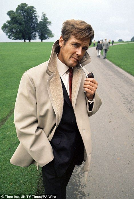 This image, also newly released by the TV Times, shows Sir Roger Moore puffing on a pipe...
