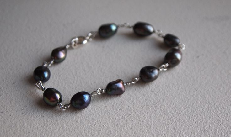 Handmade Sterling silver bracelet with freeform Tahiti pearls.