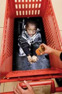 """Guerilla Marketing - For a cause..  From Feed SA a South African charitable organization that operates food programs to the poverty-stricken in SA townships. The cart's handle bears the tagline, """"See how easy feeding the hungry can be?"""" [source: Adland]"""