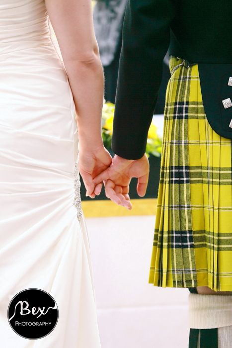 http://www.bexphotographynewquay.com Holding Hands. Groom in Cornish Tartan kilt in the traditional colours of St Piran ~ Yellow and Black theme ~ Wedding Inspiration. Photography by Bex Photography based in Newquay, Cornwall, UK.