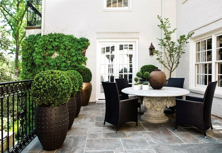 decks/patios - slate pavers marble round outdoor dining table black outdoor chairs Lush Life Home & Garden - Lovely deck patio with slate pavers,