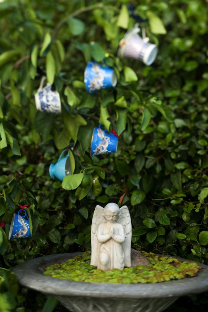A serene corner of the garden is home to a little fallen angel.