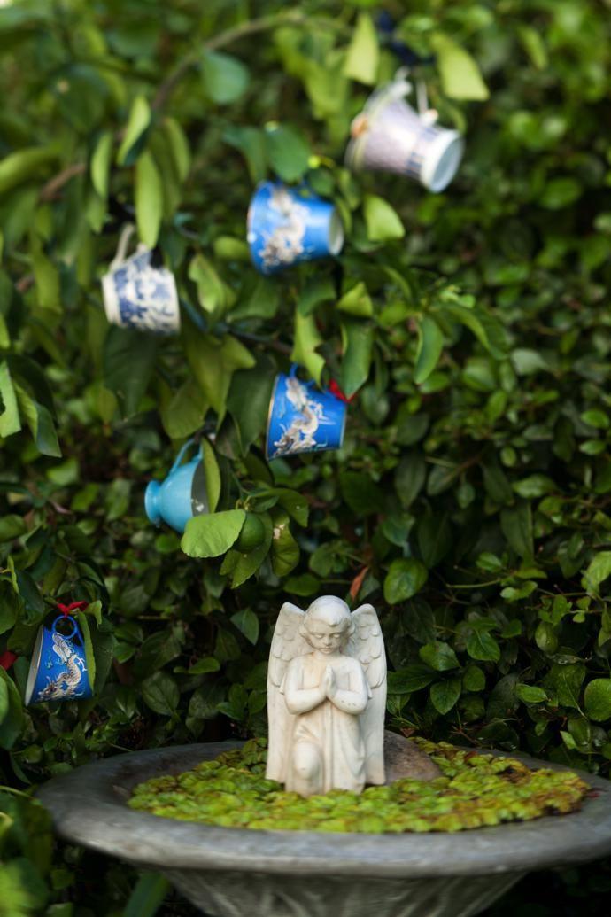A serene corner of the garden is home to alittle fallen angel.