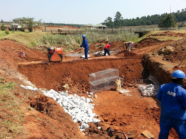 Construction of #dam wall dividing the pool area and the #settling pond