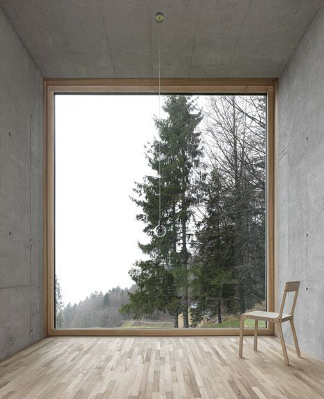 Haus Rüscher by OLKRÜF, Austria - Exposed concrete walls are sandblasted to create smooth interior surfaces on the lower level. Floors are lined with elm boards, which also clad the walls and ceilings in the bedrooms.