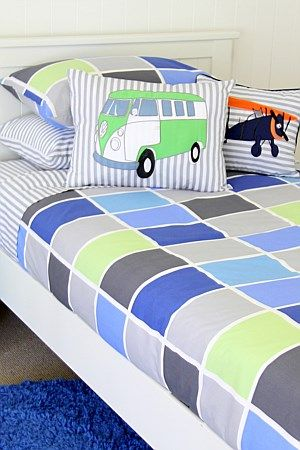 New from Patersonrose - Tom features symmetrical squares of blues, green and greys and is a striking, fresh design when teamed up with the grey and white stripe sheeting.