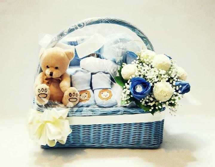 Baby gift basket & flower arrangement in container - 465K Includes: Baby Socks, Jumper, Blanket, Baby Cloth Hanger, Baby Hat &Teddy Bear