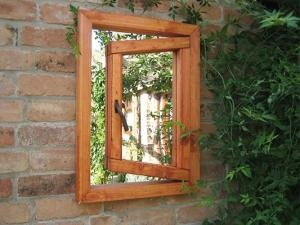 """Alice in Wonderland"" garden mirror . .  make a couple to put on the fence of the shed wall."