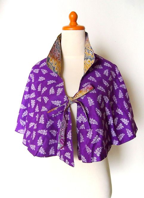 $35 Indonesian batik with two side cotton combination cape multi wear, you can wear it as cape or mini skirt. #womensfashion #womensclothing #womens #fashion #batik #purple #skirt #miniskirt #womens skirt  This cape made from 100% cotton batik material, very comfortable for daily wear . Easily maintain and the colour is still good trough often washed . Both two side are trim neatly, so you c...