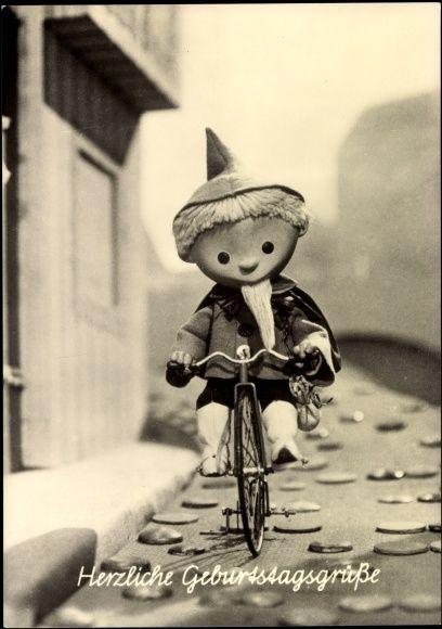 Ansichtskarte / Postkarte Glückwunsch Geburtstag, Sandmännchen auf Fahrrad