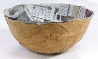 Paper mâché bowl, brown paper on the outside