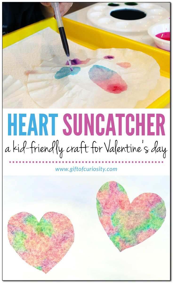 Heart suncatcher craft for Valentine's Day made from coffee filters and liquid watercolor paints #ValentinesDay #hearts || Gift of Curiosity