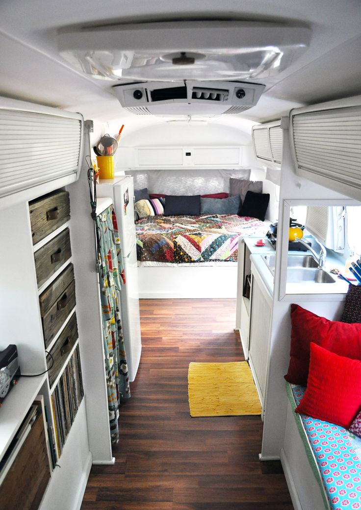 Inside a renovated Airstream trailer- Check the handles on the wood drawers: leather strip with 2 screws