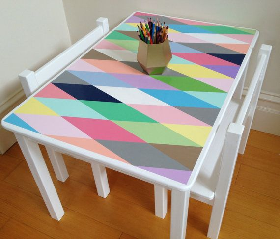 Childs table and chair set, painted in a multi- coloured harlequin design. The table top measures 90cm x 60cm, so provides ample room for play, art, meals etc, for two or four children. With this particular set, I have included two small bench seats, each measuring 56cm in length. Other seating options can be ordered, such as four separate chairs or two chairs and a bench seat, at an additional cost. The tables legs are removable for ease of transportation, shipping or for simply packing…