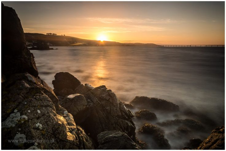 Sunset at Firth of Tay in Dundee, SCOTLAND. Rocks Highlighted by the Sunshine.