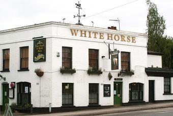 The White Horse, Dorking Road, Epsom.  Closed 2014.