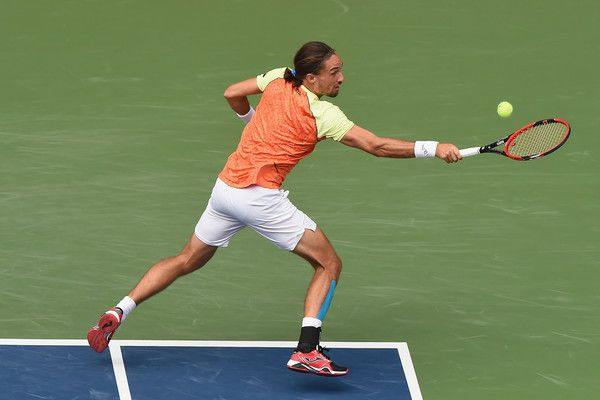 Alexandr Dolgopolov of Ukraine plays a backhand against Steve Johnson of the USA during day four of the Rakuten Open at Ariake Coliseum on October 5, 2017 in Tokyo, Japan.