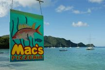 Bequia in the Caribbean -- Mac's Pizza, featuring lobster/bacon pizza. I dream of returning there.