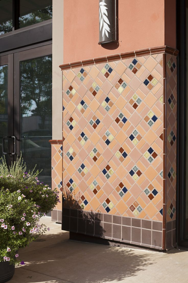 Exterior Facade Design. Product: Tile | Color: | Size: 2x8 | Pattern: