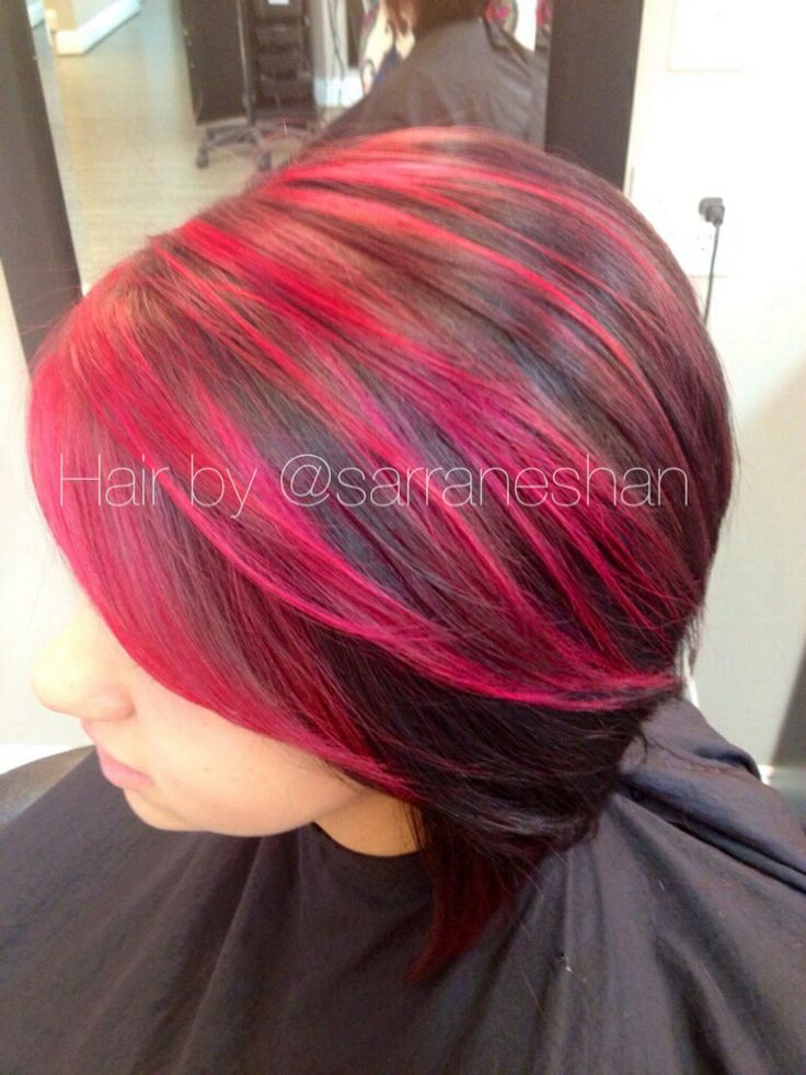 Short hair with fun red violet highlights. Hair by @Sarra Neshan of Blondies Hair Salon, Anderson, SC.