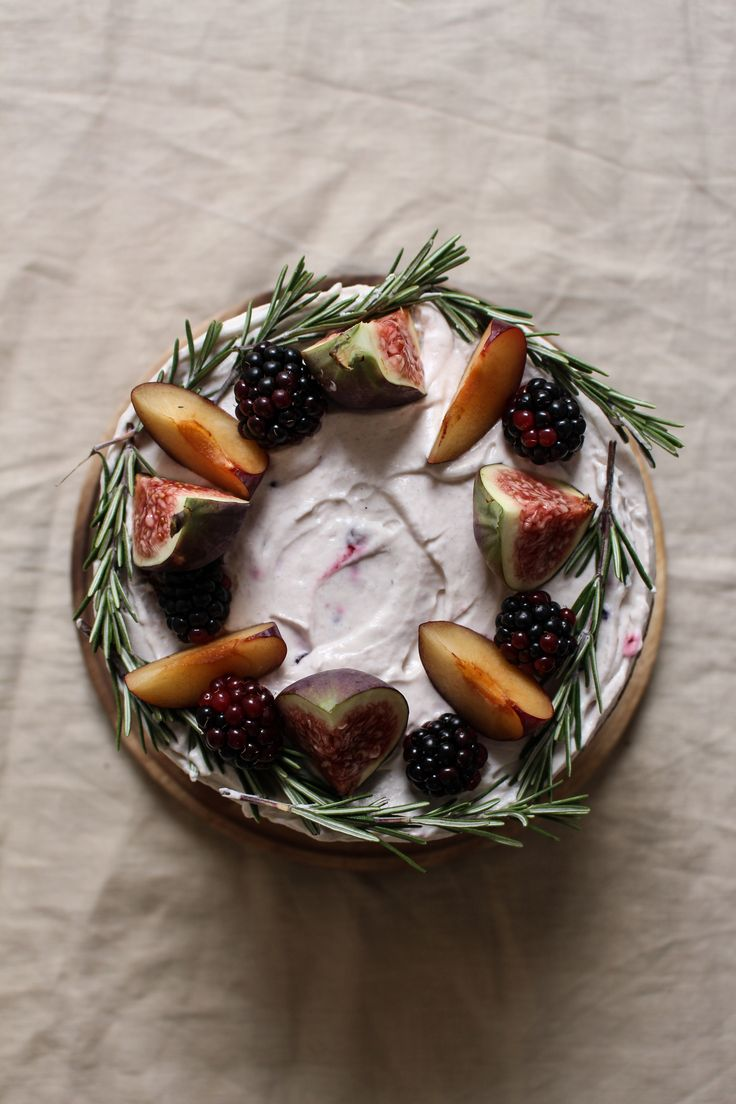 black tea poached plum and fig cake with rosemary blackberry creme fraiche frosting: