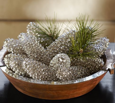Spray paint pine cones to have that mercury glass look to them. Use Krylon Looking Glass Mirror-Like Paint on pinecones, add a little fresh or faux greenery to accomplish this look.*** 10/10** this link really doesn't tell you how to do this, but it's pretty self explanatory (try adding some white twinkle lights in the bowl or apothecary jar - so pretty!)