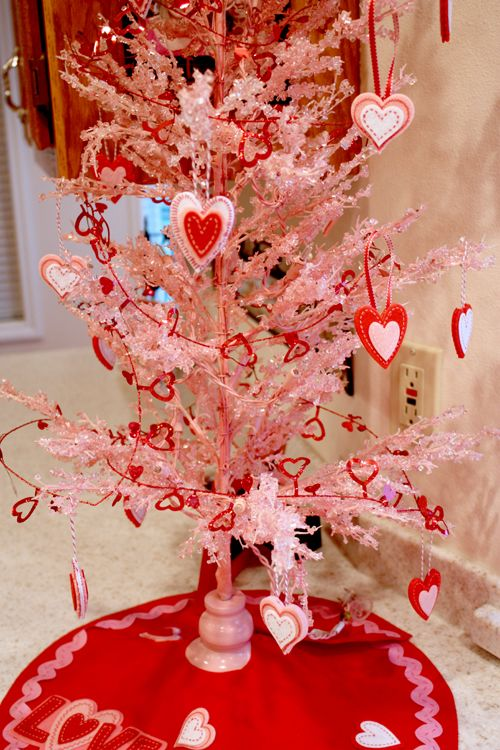 Pink Valentine's Day tree-I will be doing something similar this year. I also ordered a pink cupcake skirt to put around it to add a sweet treat!