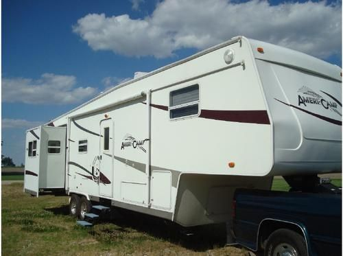 2005, Ameri-Camp SRX350RL4-BS 4 slide-outs, 15,000 BTU ac, 16 ft. awning, fully enclosed underbelly, Mor-Ryde RE,power jacks front and rear, 10 gal. DSI water heater,Sony flat screen TV, DVD home theater system, bedroom privacy door, LX package {aluminum wheels,upgraded mattress, padded ceiling, and designer fabrics} Fantastic Power vent - See more at: http://www.cacars.com/1002463.html#sthash.i5KyIjXg.dpuf