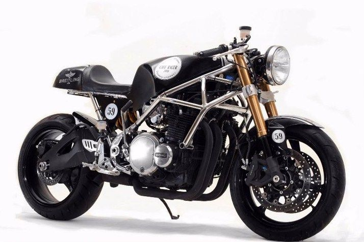 The Breitling Cafe Racer by Santiago Chopper.  Engine is from a Kawasaki Z1000, with a George Martin Frame, Swing arm, wheels and suspension are from a 2007 Suzuki GSX-R600. It also has a Benelli seat.
