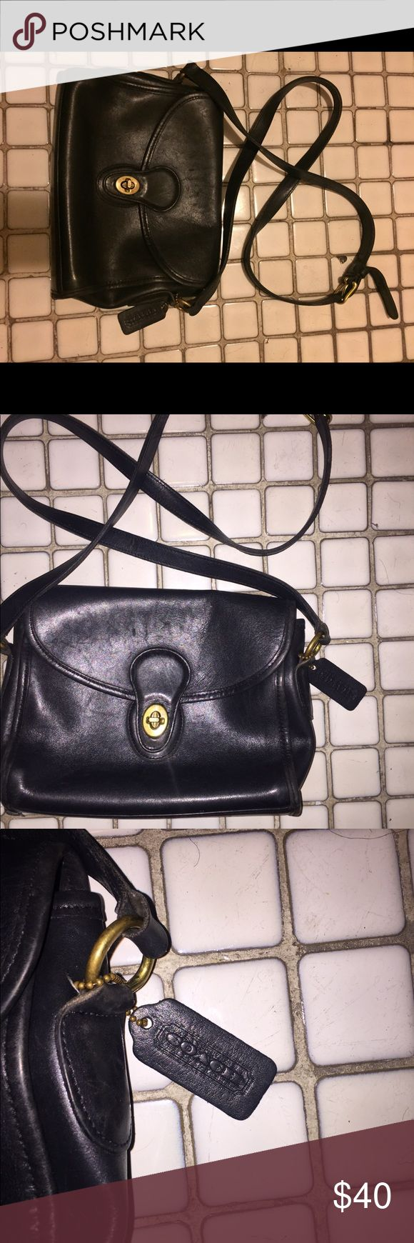 Black cross body bag Used but in fair condition cross body bag, it states coach I don't know if it's authentic. Adjustable straps, pics tell all. Good cross body bag! Make me an reasonable offer:) Coach Bags Crossbody Bags