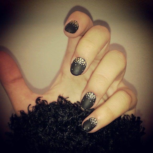 Black mat nail polish and gold glitters