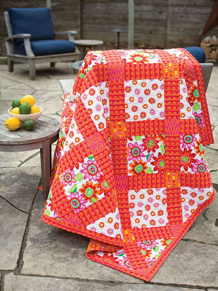 There are no quilt blocks to make in this quilt. Use a tropical fabric print and sew large squares and rectangles together to make this summery quilt.
